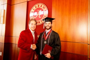 Nick Saban poses with Blaine Anderson, one of more than 30 Crimson Tide student-athletes graduation from the University of Alabama Saturday. (Robert Sutton/UA Athletics)