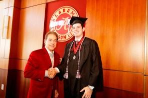 Nick Saban poses with David Cornwell, one of more than 30 Crimson Tide student-athletes graduation from the University of Alabama Saturday. (Robert Sutton/UA Athletics)