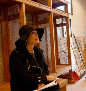 Marie Wilson takes in the history in the locker room at Rickwood Field. (Solomon Crenshaw Jr. / Alabama NewsCenter)