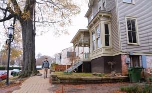 John Veres walks through the neighborhood he has taken a role in restoring. (Karim Shamsi-Basha/Alabama NewsCenter)