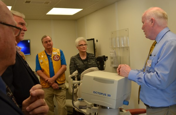 The Alabama Lions' first Mobile Eye and Vision Clinic has hit the road to bring eye care to thousands of underserved Alabamians. Dr. Kent Daum, the clinic's director, talks with a group at the official launch. (Michael Tomberlin/Alabama NewsCenter)