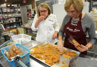Sampling the product for quality is both business and pleasure for Nancy Curl and her employees. (Karim Shamsi-Basha/Alabama NewsCenter)