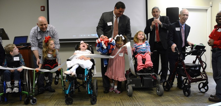 UCP of Greater Birmingham cut the ribbon to mark its name change to United Ability. (Karim Shamsi-Basha / Alabama NewsCenter)