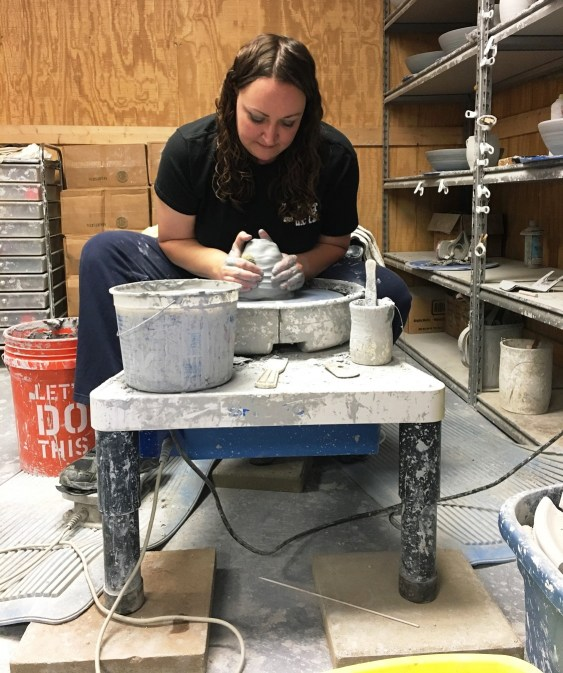 Beth Wilson molds clay into a bowl for her company, The Potter and the Clay. (Brittany Faush-Johnson/Alabama NewsCenter)