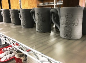 Mugs made by The Potter and the Clay bear Beth Wilson's signature twist in the handles. (Brittany Faush-Johnson/Alabama NewsCenter)