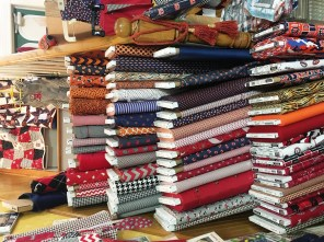 Keeping in mind what state her store is in, Pat Drake carries a large selection of fabrics in Alabama and Auburn colors. (Brittany Faush-Johnson/Alabama NewsCenter)