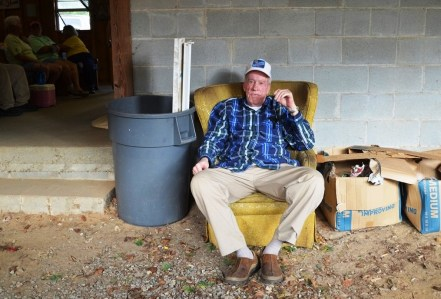 A patron relaxes outside the auction room. (Anne Kristoff/Alabama NewsCenter)