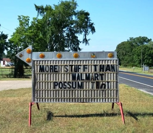 A sign at Possum Trot Auction makes a bold claim. (Anne Kristoff/Alabama NewsCenter)