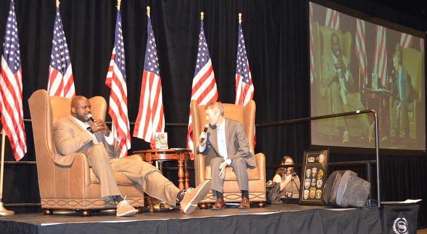 Jeff Speegle, left, sports anchor for ABC 33/40, asks Shaquille O'Neal questions at the 2017 American Values Luncheon. (Michael Tomberlin / Alabama NewsCenter)