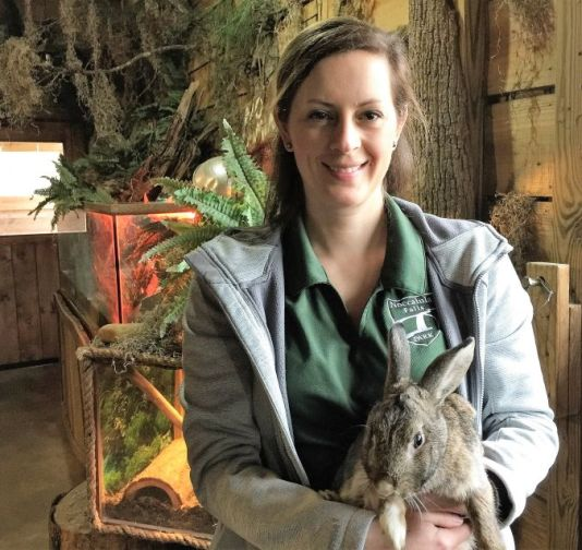 Richardson holds a rabbit at the petting zoo. (Donna Cope / Alabama NewsCenter)