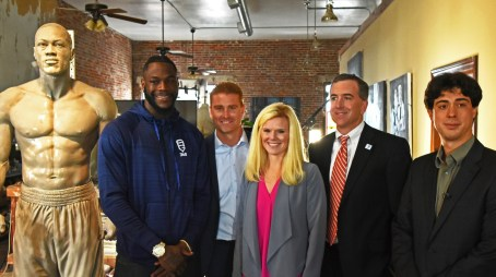Deontay Wilder with artist Caleb O'Connor, right, and officials in O'Connor's studio. (Solomon Crenshaw Jr./Alabama NewsCenter)