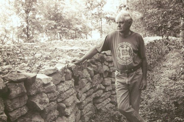 """The photo of Tom Hendrix and the wall from the jacket of his book """"If the Legend Fades."""" (contributed)"""