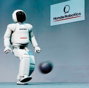 ASIMO is a humanoid robot designed to perform functions around the home. (Honda)