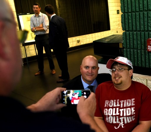 Tony Berenotto snaps a photo of his son Joshua Berenotto, right, with Southern Professional Hockey League Commissioner Jim Combs. Father and son were on hand for the announcement that the Birmingham Bulls were approved to play in the SPHL in the fall of 2017. (Solomon Crenshaw Jr. / Alabama NewsCenter)
