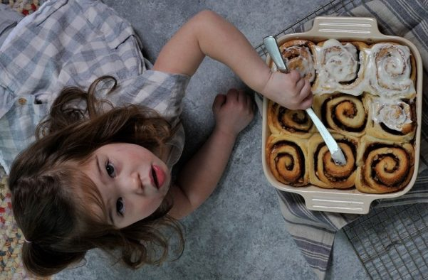 Aimee Wood adds icing to the hazelnut cinnamon rolls. (Ted Tucker/Shorelines)