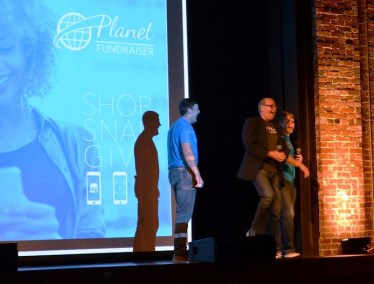 Dennis Leonard from Alabama Power's Innovation Team, center, introduces Planet Fundraiser co-founders Drew Honeycutt, left, and Kasey Birdsong. (Michael Tomberlin / Alabama NewsCenter)