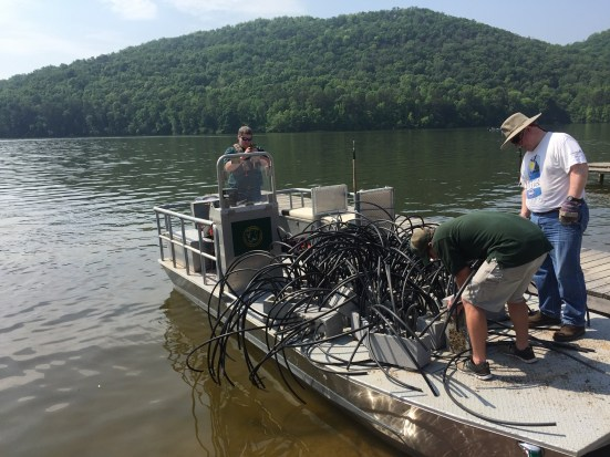 Members of the Neely Henry Lake Association prepare to sink fish habitat made from concrete and PVC pipe, which they expect to last 20 years or more. Wooden habitat tends to decay in three to five years. (Allison Westlake/Alabama NewsCenter)