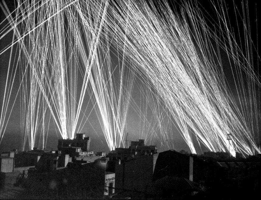 Anti-aircraft fire during a Luftwaffe air raid on Algiers in 1943, the year Alvin Vogtle was captured by the Nazis while on a secret mission. (Lt. W.R. Wilson, U.S. Army, Wikimedia)