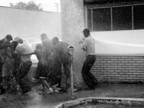 "During the Birmingham campaign of 1963, City Commissioner Eugene ""Bull"" Connor jailed hundreds of protesters and authorized the use of fire hoses and police dogs on others. This image was one of many published in the mass media that raised a public outcry to end civil rights abuses in the South. (From Encyclopedia of Alabama, courtesy of The Birmingham News. All rights reserved. Used with permission.)"