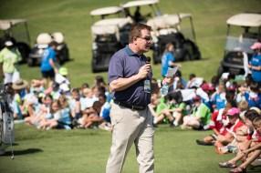 Regions Tradition executive director Gene Hallman talks with children about golf and values. (Christopher Jones/Alabama NewsCenter)