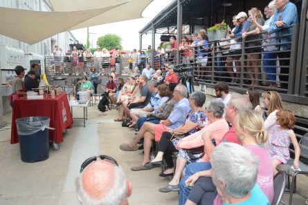 A large crowd watched Fuller Goldsmith cook at the Market at Pepper Place. (Karim Shamsi-Basha / Alabama NewsCenter)