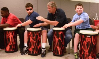 Homewood Middle School Band Director Chris Cooper, who created the Synergy program last year, enjoys playing alongside the students while Lauren Nowak leads the group. (Karim Shamsi-Basha/Alabama NewsCenter)
