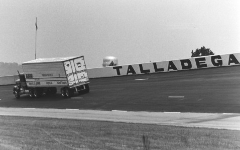 In 1975, Johnny Ray set a world record at Talladega Superspeedway on a closed-course for a semi tractor-trailer at 92.083 mph. Ray now volunteers at the Superspeedway as a member of the White Flag Club and will take to the track during pre-race ceremonies as he makes the iconic drive-by in his diesel big-rig, decked out with a giant American Flag. (Getty Images)