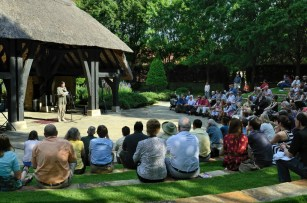 """The producing artistic director of the Alabama Shakespeare Festival, Geoffrey Sherman, reading Shakespeare's Sonnet 71, """"No longer mourn for me when I am dead,"""" on the 447th anniversary of Shakespeare's birth. The event was held in the Shakespeare Garden at the ASF. (Ralph Daily, Flickr)"""