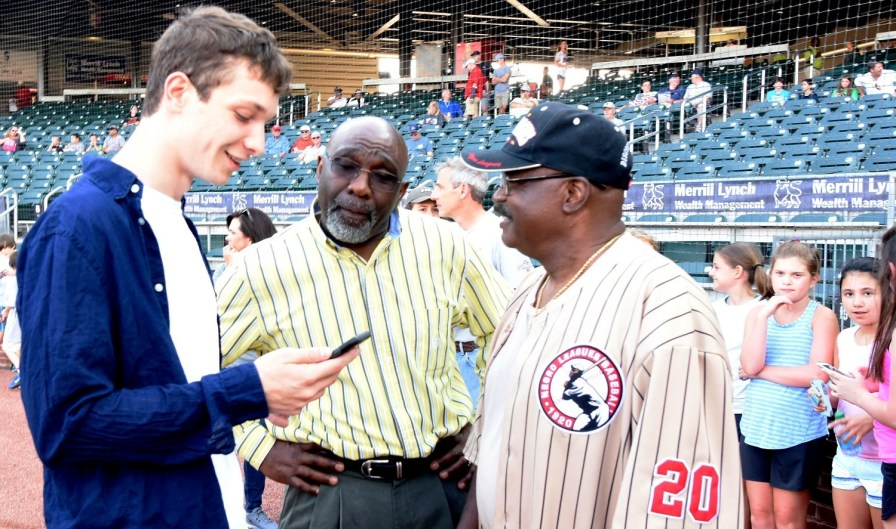 Cam Perron, left, started out as a kid looking for baseball players' autographs, but the important role he has played in some of those players' lives has drawn the interest of a Hollywood screenwriter. (Solomon Crenshaw Jr./Alabama NewsCenter)