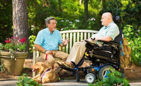 Benintende (left) advises Miller about strengthening exercises. (Phil Free/Alabama NewsCenter)
