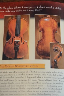 A few of the Violins of Hope. (Karim Shamsi-Basha / Alabama NewsCenter)