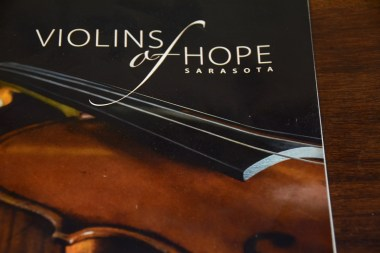 The program from Violins of Hope Sarasota contains images of the instruments. (Karim Shamsi-Basha / Alabama NewsCenter)