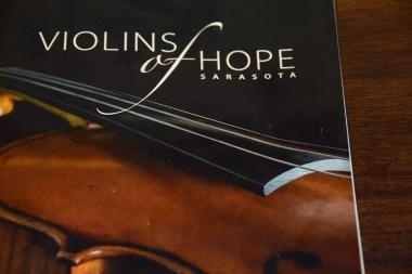 The program from Violins of Hope Sarasota contains images of the instruments. (Karim Shamsi-Basha / Alabama NewsCenter)