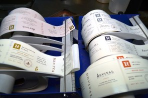 Labels for the different blends await backs of roasted coffee at Revival Coffee in Selma. (Michael Tomberlin / Alabama NewsCenter)