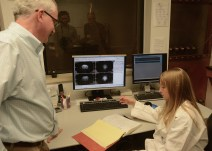 Megan Rich discusses her work with Civitan International's Terry Schrimscher. (Karim Shamsi-Basha/Alabama NewsCenter)