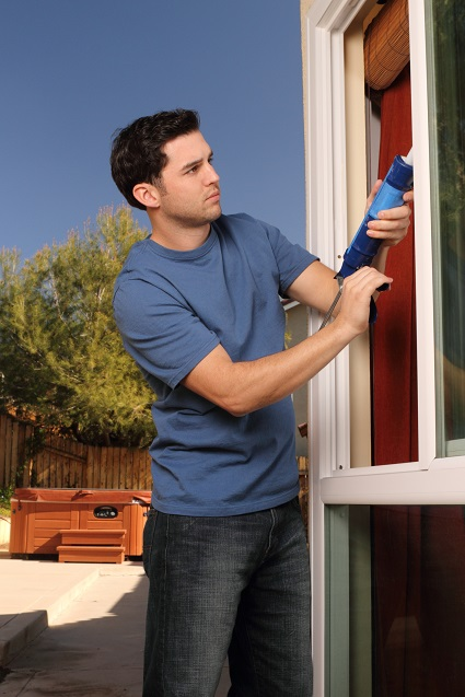 Caulking keeps cool air in and hot air out. (Getty Images)