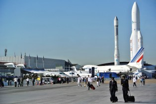 Ariane rockets loom in the distance as visitors check out the aircraft on display at the 2017 Paris Air Show. (Contributed)
