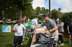 Attendees pick up merchandise. (Christopher Jones/Alabama NewsCenter)