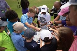 The children build a heap of Barbasol shaving cream. (Christopher Jones/Alabama NewsCenter)