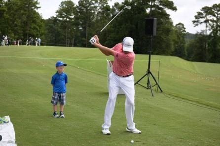 Davis Love III demonstrates his swing. (Christopher Jones/Alabama NewsCenter)