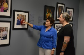 Cathy Friedman talks about a display at the Birmingham Holocaust Education Center with Rebecca Dobrinski,the center's executive director. (Karim Shamsi-Basha/Alabama NewsCenter)