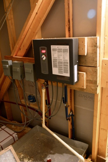 A tankless water heater is among the energy efficiency technologies in the Ideal Home. (Karim Shamsi-Bashi / Alabama NewsCenter)