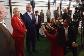Gov. Kay Ivey and state Sen. Greg Reed speak with the press after the ceremony. (Karim Shamsi-Basha / Alabama NewsCenter)
