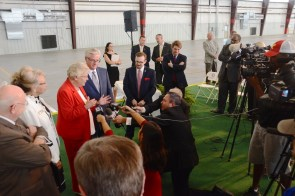 Gov. Kay Ivey and state Sen. Greg Reed speak with the press after the ceremony. (Karim Shamsi-Basha / Alabama NewsCenter)