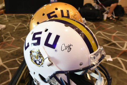 LSU helmets signed by coach Ed Orgeron. (Solomon Crenshaw Jr. / Alabama NewsCenter)
