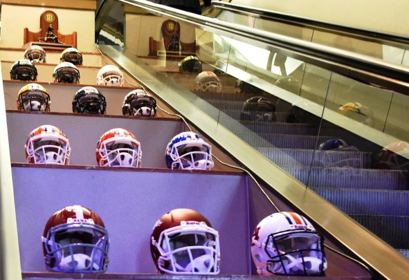 SEC team helmets and the conference trophy line the escalators at the Hyatt Regency Wynfrey Hotel for SEC Media Days. (Solomon Crenshaw Jr. / Alabama NewsCenter)