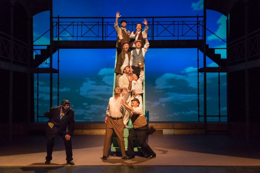 "Jeff Wilson as the umpire and L to R, bottom to top on the stairs: Josh Kauffman, Bradley Logan, Brent Jones, Murphy Branch, George Thagard, Landon Turner, Colton Crowe, and Royce Garrison in Theatre Tuscaloosa's upcoming production of ""Ragtime,"" running July 14-23 in the Bean-Brown Theatre. Photo by P. Solorzano."