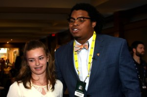 Tennessee offensive lineman Jashon Robertson, right, poses with a fan. (Solomon Crenshaw Jr. / Alabama NewsCenter)