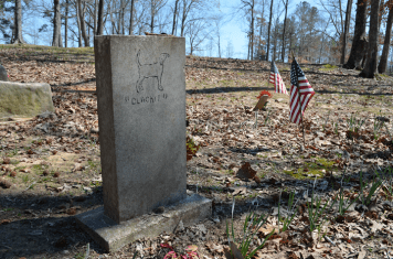 A handcarved headstone for a dog named Blackie in the Coon Dog Cemetery. (Anne Kristoff / Alabama NewsCenter)