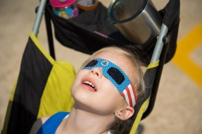 Zoey Jordan watches the solar eclipse at McWane Science Center. (Phil Free / Alabama NewsCenter)